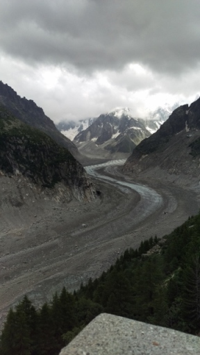 You can see the glacier end curving in between the mountains