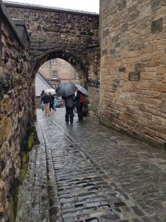 Arches, cobbled streets...and umbrellas everywhere